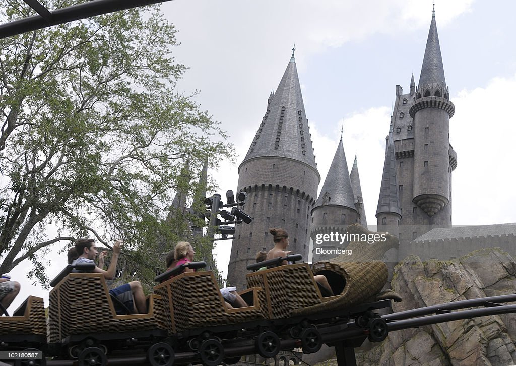 Guests ride on the Flight of the Hippogriff past Hogwarts castle at the Universal Studios Wizarding World of Harry Potter theme park in Orlando, Florida, U.S., on Thursday, June 17, 2010. Universal reportedly spent $265 million building the theme park, based on a Securities & Exchange Commission filing. Photographer: Phelan M. Ebenhack/Bloomberg via Getty Images