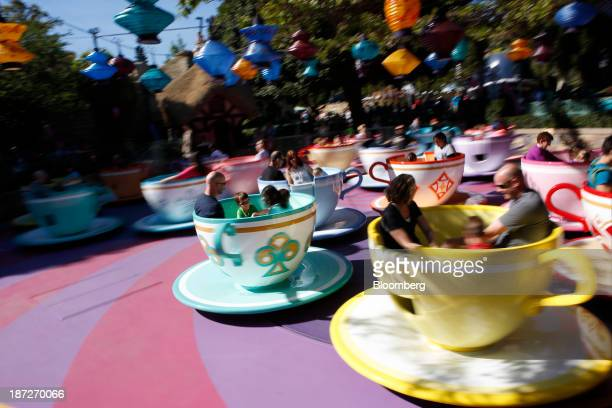 Guests ride the Tea Cups at Walt Disney Co's Disneyland Park part of the Disneyland Resort in Anaheim California US on Wednesday Nov 6 2013 The Walt...