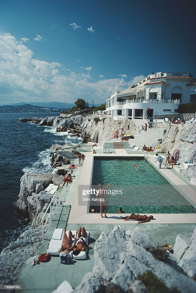 Guests Round The Swimming Pool At Hotel Du Cap Eden Roc Antibes