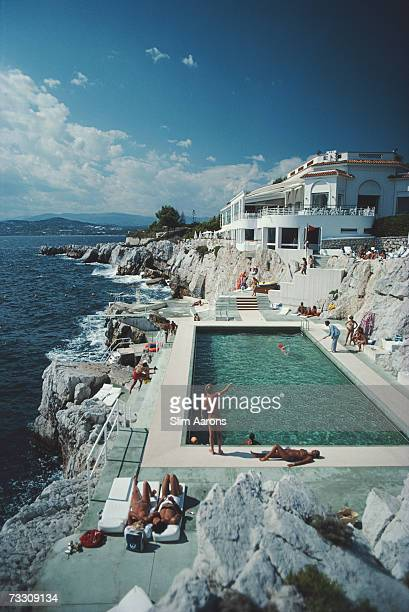 Guests round the swimming pool at the Hotel du Cap Eden-Roc, Antibes, France, August 1976.