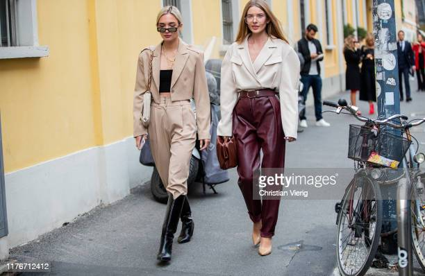 Guests seen outside Boss during Milan Fashion Week Spring/Summer 2020 on September 22 2019 in Milan Italy