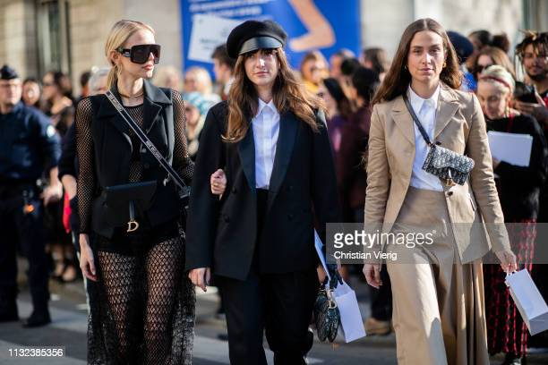 Guests seen outside Dior during Paris Fashion Week Womenswear Fall/Winter 2019/2020 on February 26 2019 in Paris France