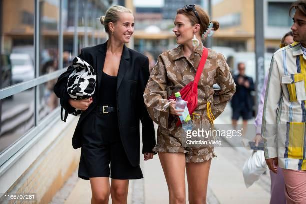 Guests seen outside Holzweiler during Copenhagen Fashion Week Spring/Summer 2020 on August 07, 2019 in Copenhagen, Denmark.
