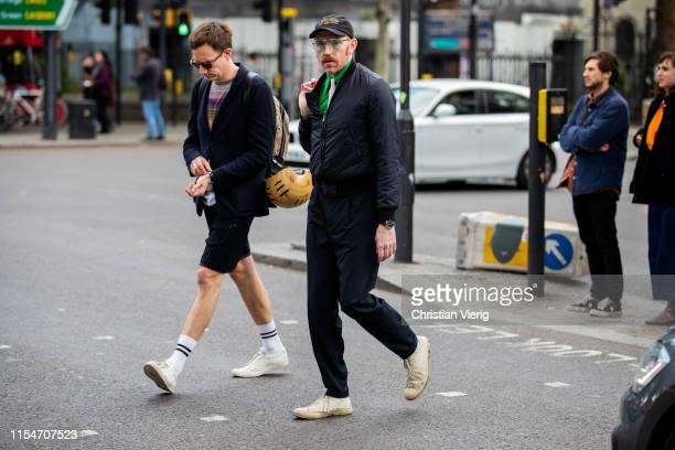 Guests seen outside John Lawrence Sullivan during London Fashion Week Men's June 2019 on June 08, 2019 in London, England.