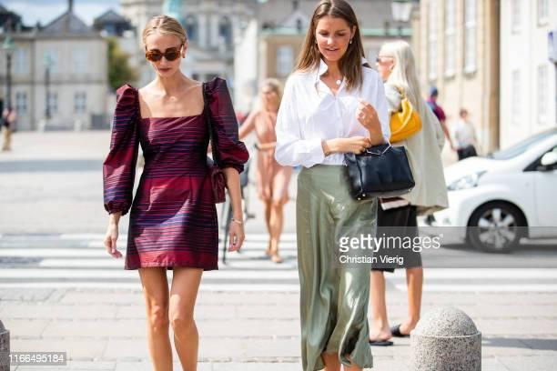 Guests seen outside Mykke Hofmann during Copenhagen Fashion Week Spring/Summer 2020 on August 06, 2019 in Copenhagen, Denmark.