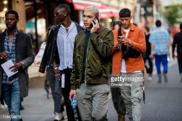 Guests seen outside Qasimi during London Fashion Week Men's June 2019 on June 08 2019 in London England