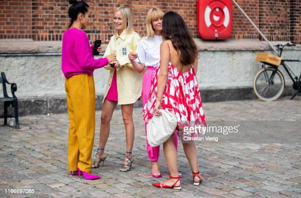 Guests seen outside Rodebjer during Copenhagen Fashion Week Spring/Summer 2020 on August 07, 2019 in Copenhagen, Denmark.