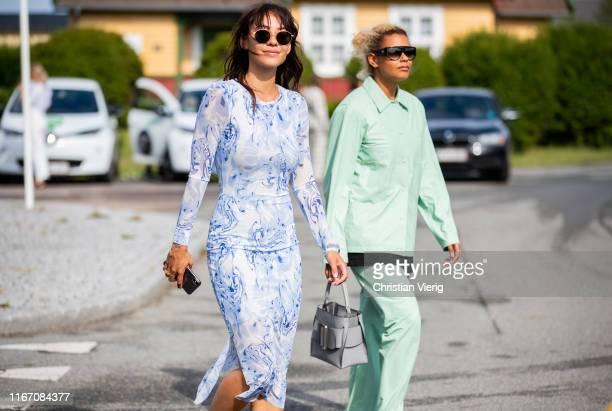 Guests seen outside Stine Goya during Copenhagen Fashion Week Spring/Summer 2020 on August 08, 2019 in Copenhagen, Denmark.