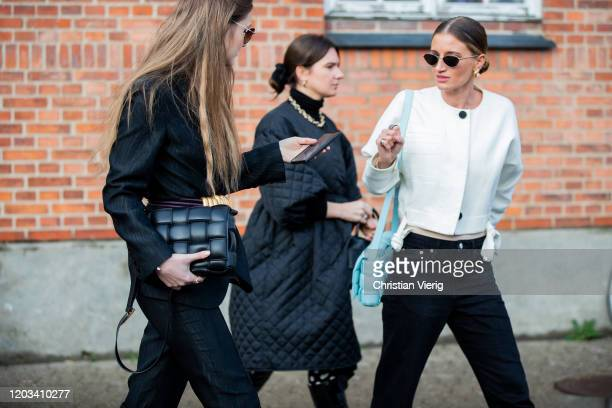 Guests seen texting with their phone outside By Malene Birger during Copenhagen Fashion Week Autumn/Winter 2020 Day 3 on January 30, 2020 in...
