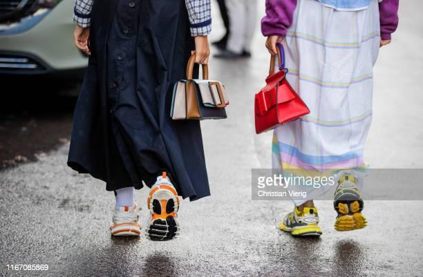 Guests seen wearing Balenciaga sneaker, Boyy bag outside Saks Potts during Copenhagen Fashion Week Spring/Summer 2020 on August 08, 2019 in...