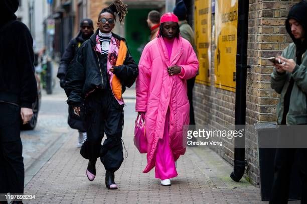 Guests seen wearing bomber jacket pink down feather coat during London Fashion Week Men's January 2020 on January 05 2020 in London England