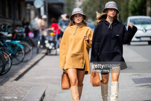 Guests seen wearing bucket hat and hoody, brown bag, boots outside Holzweiler during Copenhagen Fashion Week Spring/Summer 2020 on August 07, 2019 in...