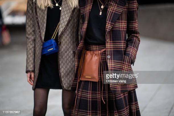 Guests seen wearing Jacquemus bag plaid blazer Gucci blazer maxi skirt black dress sheer tights at the Hera Seoul Fashion Week 2019 F/W at Dongdaemun...
