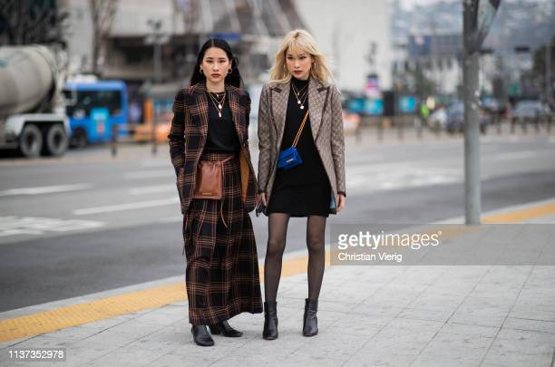 Guests seen wearing Jacquemus bag plaid blazer Gucci blazer maxi skirt black dress sheer tights at the Hera Seoul Fashion Week 2019 F/W at Dongdaemun...
