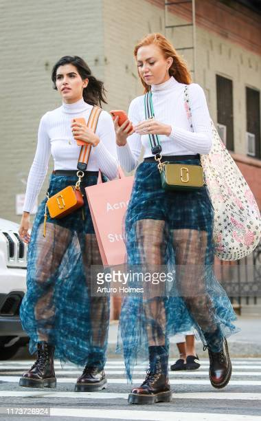 Guests seen wearing matching blue transparent skirts and cordovan boots Cynthia Rowley show during New York Fashion Week on September 10, 2019 in New...