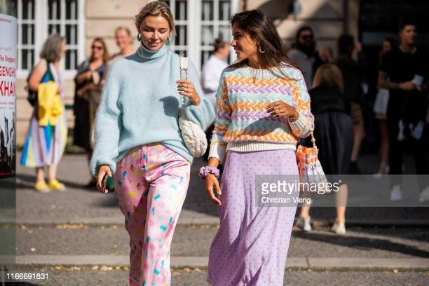 Guests seen wearing pastel knit, pink skirt, pants outside Helmstedt during Copenhagen Fashion Week Spring/Summer 2020 on August 07, 2019 in...