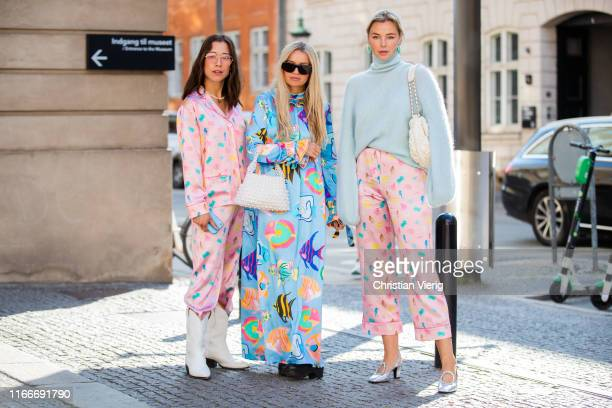 Guests seen wearing pink midi skirt, pastel knit, dress with graphic print outside Helmstedt during Copenhagen Fashion Week Spring/Summer 2020 on...