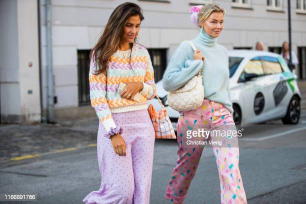 Guests seen wearing pink midi skirt, pastel knit outside Helmstedt during Copenhagen Fashion Week Spring/Summer 2020 on August 07, 2019 in...