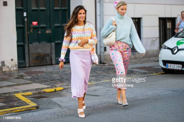 Guests seen wearing pink midi skirt pastel knit outside Helmstedt during Copenhagen Fashion Week Spring/Summer 2020 on August 07 2019 in Copenhagen...