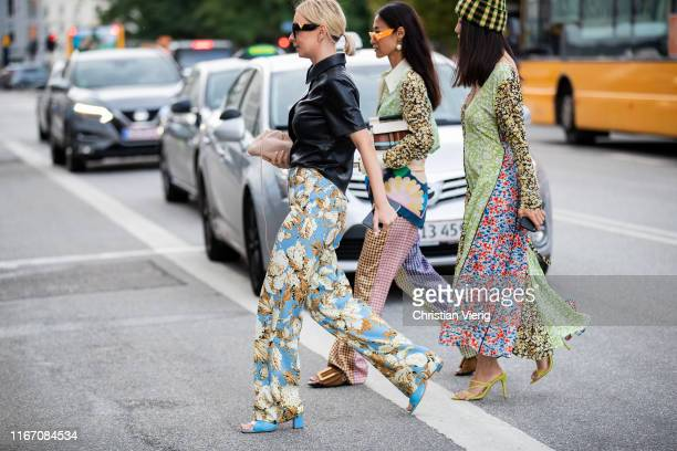 Guests seen wearing prints and pattern outside Ganni during Copenhagen Fashion Week Spring/Summer 2020 on August 08 2019 in Copenhagen Denmark