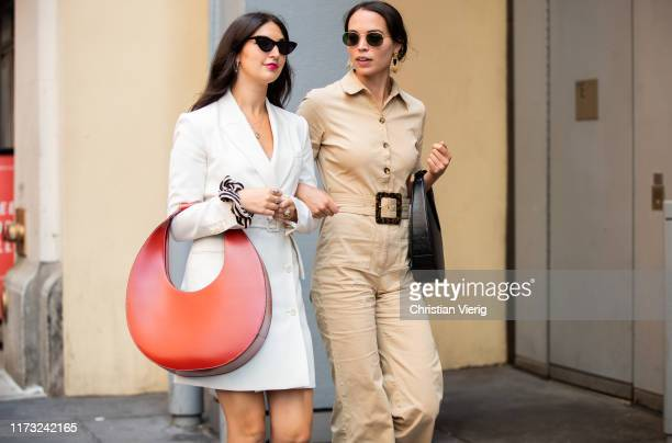Guests seen wearing red bag white blazer outside Tibi during New York Fashion Week September 2019 on September 08 2019 in New York City