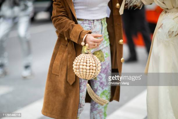 Guests seen wearing round bag outside Zimmermann during New York Fashion Week Autumn Winter 2019 on February 11, 2019 in New York City.