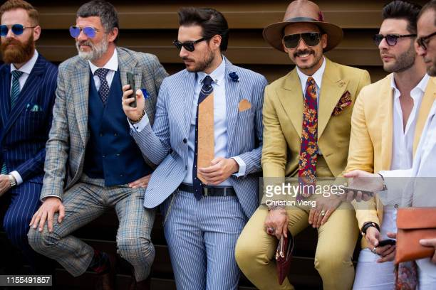 Guests seen wearing suits during Pitti Immagine Uomo 96 on June 12 2019 in Florence Italy