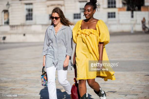 Guests seen wearing yellow dress outside Fyodor Golan during London Fashion Week September 2019 on September 14, 2019 in London, England.