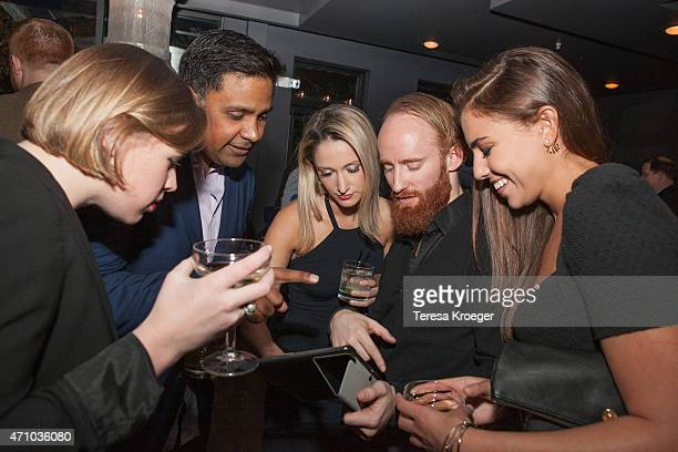 Guests select music for a Spotify playlist at The Evening Before a preWhite House Correspondents' Dinner party hosted by Eric Podwall and Spotify at...