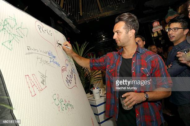 Guests sign a Casper mattress during Casper's LA celebration at Blind Dragon on July 9 2015 in West Hollywood California