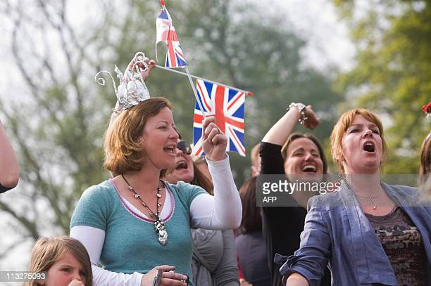 Guests sing along to the entertainment at a Tea in the Park event in Kate Middleton's home village of Bucklebury on April 29 2011 AFP PHOTO / CHRIS...