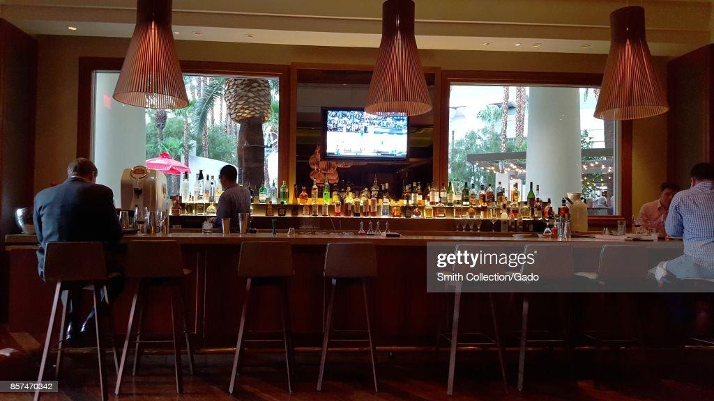 Guests sit in a bar area at Mandalay Bay Resort and Casino, in Las Vegas, Nevada, 2016.