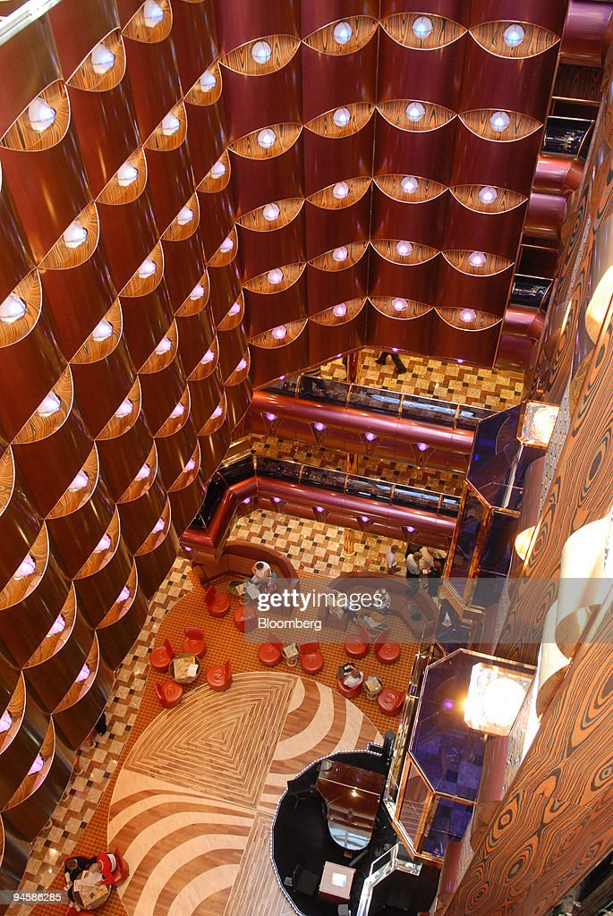 Guests Sit Inside A Lounge Area On The Carnival Cruise