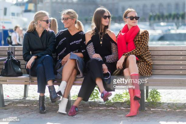 Guests sitting on a bench outside Whyred on August 30 2017 in Stockholm Sweden