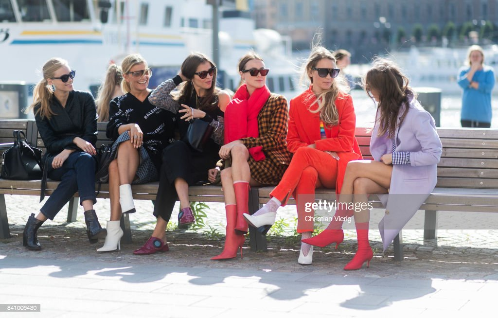 Guests sitting on a bench outside Whyred on August 30, 2017 in Stockholm, Sweden.
