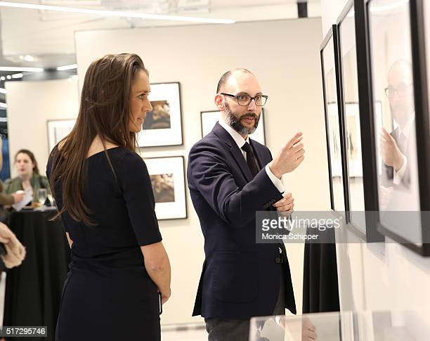 Guests speak during the Stories Untold Conde Nast Collection Presented By Getty Images Opening Celebration at The Conde Nast Gallery on March 24 2016...