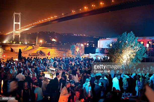 Guests spend the evening in the club Reina at the shoreline of the Bosporus and under the Bosporus Bridge in the district Ortakoy on May 27 2005 in...