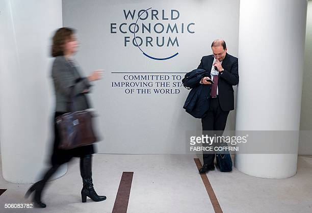 TOPSHOT Guests stand at the Congress Centre during the World Economic Forum annual meeting in Davos on January 21 2016 Rising risks to the global...