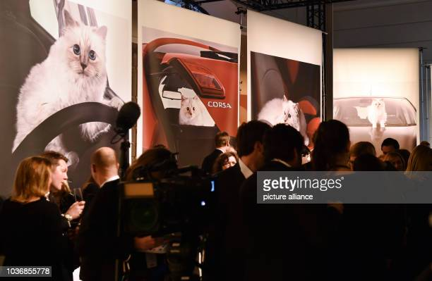 Guests stand at the vernissage for Karl Lagefeld's photo calender 'Corsa Karl and Choupette' at the Palazzo Italia in Berlin Germany 03 February 2015...