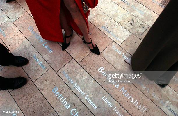 Guests stand by names of donors at the Inaugural Gala at the Walt Disney Concert Hall designed by architect Frank Gehry The building was lit with...