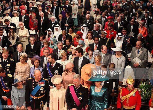 Guests stand for the arrival of Queen Elizabeth II in Westminster Abbey ahead of the Royal Wedding of Prince William to Catherine Middleton at...