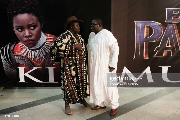 Guests stand in front of an image of Kenyan actress Lupita Nyong'o before the African premier of the Marvel film 'Black Panther' in Kisumu Kenya on...