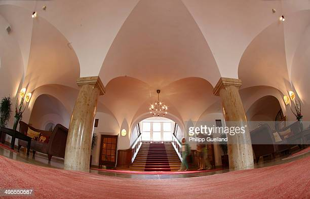 Guests stroll thorugh the lobby at Schloss Elmau, a luxury spa hotel, in the Bavarian Alps of southern Germany on June 3, 2014 in Kruen near...