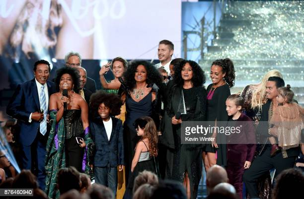 Guests such as Smokey Robinson Berry Gordy host Tracee Ellis Ross and Evan Ross stand onstage as Rhonda Ross Kendrick presents the Lifetime...