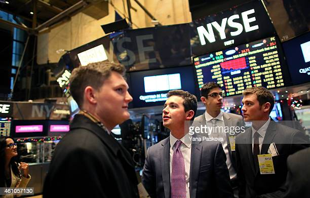 Guests take a look around the New York Stock Exchange on January 05 2015 in New York City US stocks fell over 330 points due to a plunge in energy...