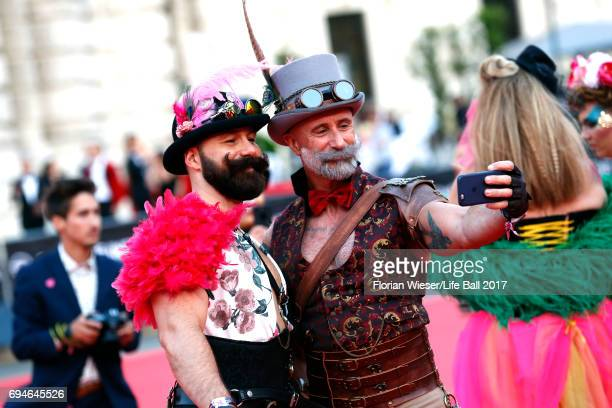Guests take a selfie as they arrive for the Life Ball 2017 at City Hall on June 10 2017 in Vienna Austria