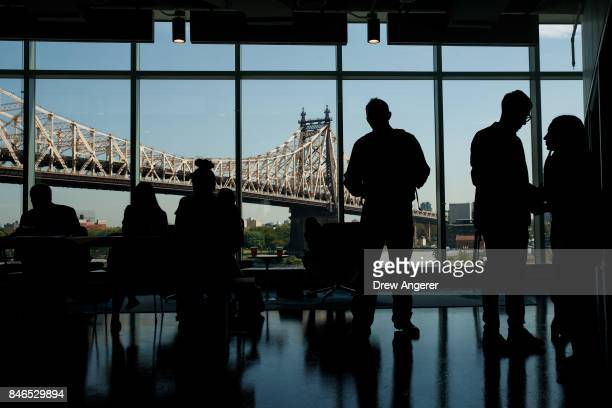 Guests take a tour of the The Bridge' building on the new campus of Cornell Tech on Roosevelt Island, September 13, 2017 in New York City. Seven...
