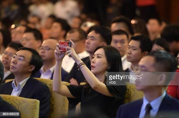 Guests take photos at 'Exploring the New Digital Ecosystem' session during the China International Big Data Industry Expo 2018 at Guiyang...
