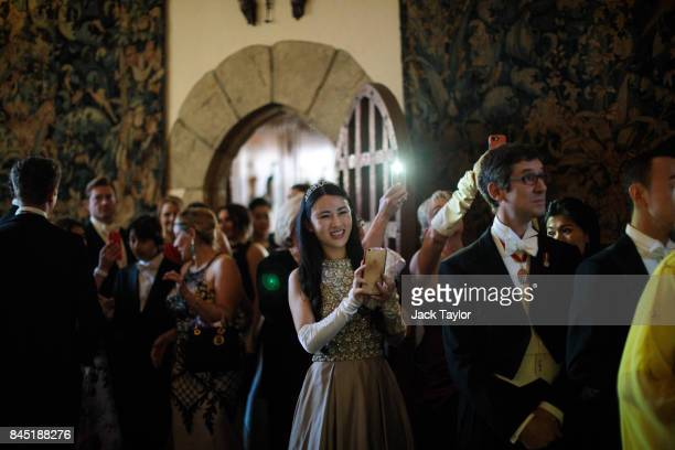 Guests take pictures and look on as debutantes arrive at Leeds Castle during the Queen Charlotte's Ball on September 9 2017 in Maidstone England In...