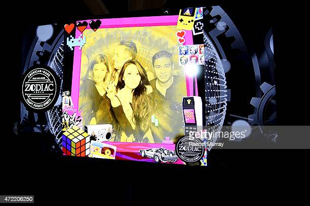 Guests take pictures at a photobooth during an exclusive launch party introducing Zodiac Vodka to the California market hosted by Zodiac Vodka and...